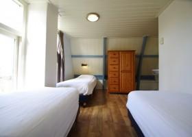 Waddenrust slaapkamer.jpg Vakantiehuisjes Waddenrust  30pluskids