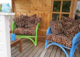 La Papillon Colibri terras houten huisje Camping & Glamping La Papillon Colibri 30pluskids