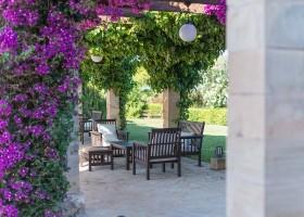 Hotel Migjorn op Mallorca, Spanje zitje onder pergola Hotel Migjorn**** 30pluskids